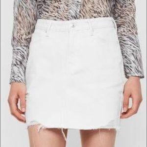 Distressed white denim jean skirt